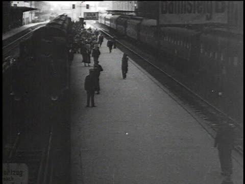 1930s montage busy railroad station / berlin, germany - bahnhof stock-videos und b-roll-filmmaterial