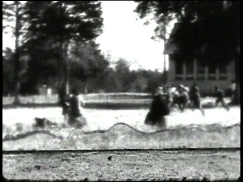 1930s montage children playing outside schoolhouse / south carolina, united states - schoolhouse stock videos & royalty-free footage