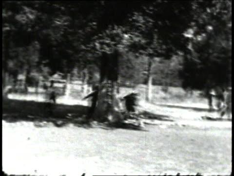 1930s montage children playing outside schoolhouse / south carolina, united states - 分校点の映像素材/bロール