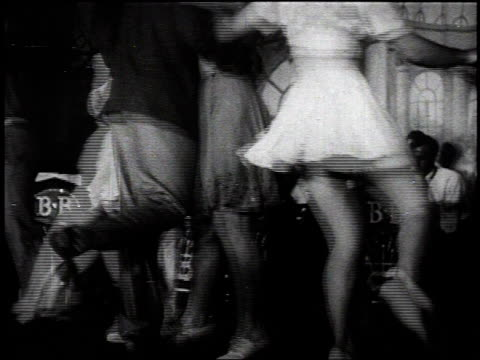 vidéos et rushes de 1930s montage couples on dance floor doing the jitterbug / united states - rock