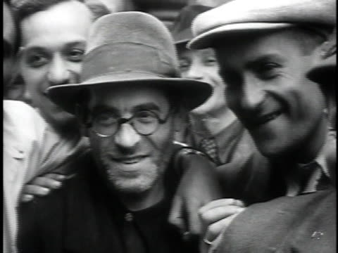 1930s montage crowd of jewish men and women looking at camera laughing smiling / dombrova poland - judaism stock videos & royalty-free footage
