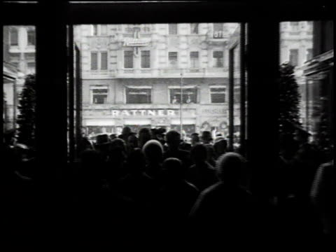 1930s montage crowd walking slowly through large doorways / berlin, germany - 1930 stock videos and b-roll footage
