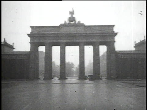 1930s montage empty brandenburg gate, street cleaning trucks and men / berlin, germany - 1930 stock-videos und b-roll-filmmaterial