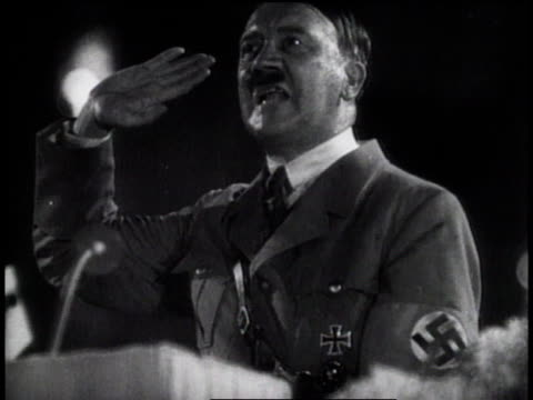 vídeos de stock, filmes e b-roll de 1930s montage hitler giving animated speeches and nazi salute / germany - adolf hitler