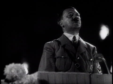 1930s MONTAGE Hitler giving animated speeches crowds cheering and giving the Nazi salute / Germany