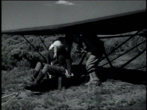 1930s montage man boarding and taking off in a hang glider / badger mountain, washington, united states - gliding stock videos and b-roll footage