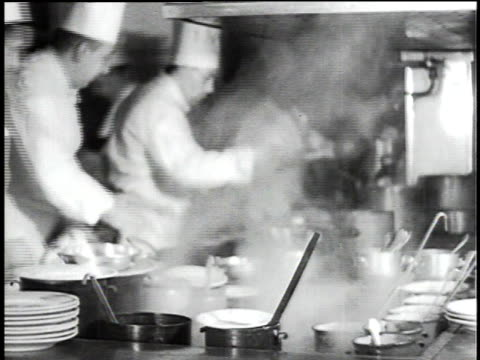 vídeos de stock e filmes b-roll de 1930s montage restaurant serving food to diners / berlin, germany - cozinha industrial
