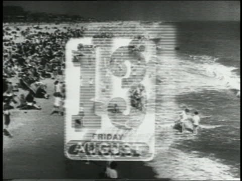 B/W 1930s MULTIPLE EXPOSURE high angle PAN calendar pages flip by over crowded beach