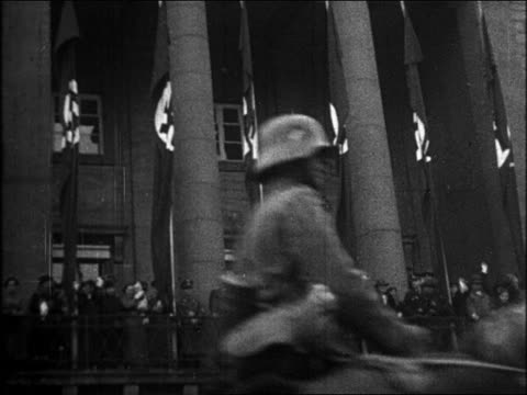 b/w 1930s nazi soldiers riding horses past building with waving people nazi flags / rhineland - herbivorous stock videos & royalty-free footage