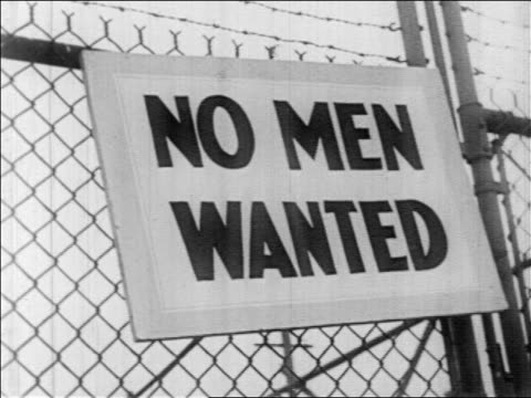 b/w 1930s no men wanted sign on chain link fence / great depression - crisscross stock videos & royalty-free footage