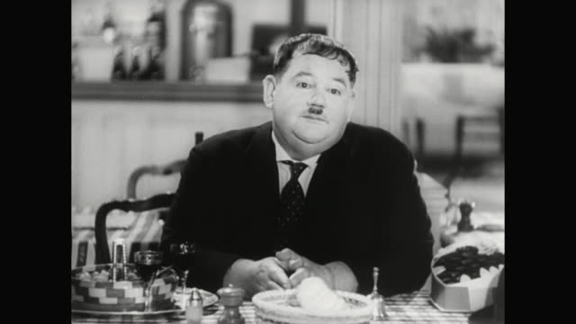 1930s oliver hardy takes back the gifts he gave to woman (jean parker) - 1930 1939 stock-videos und b-roll-filmmaterial