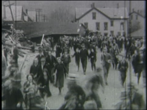b/w 1930s panicked crowd running in town street - crowd running scared stock videos & royalty-free footage