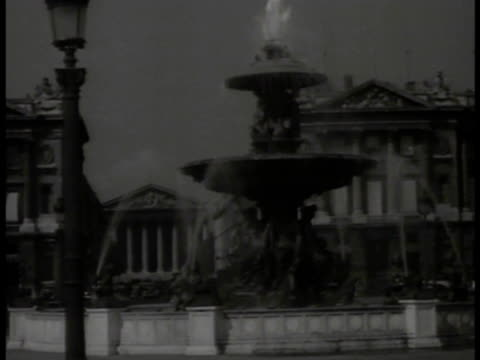 paris france ws place de la concord fountain w/ rue royale church of saintemarie madeleine bg ws west facade of cathedrale de notre dame ws men... - rue royale stock-videos und b-roll-filmmaterial