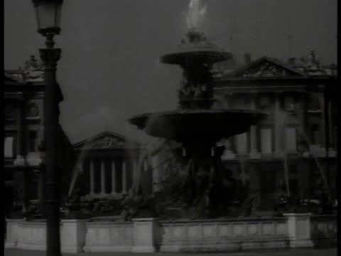 stockvideo's en b-roll-footage met paris france ws place de la concord fountain w/ rue royale church of saintemarie madeleine bg ws west facade of cathedrale de notre dame ws men... - rue royale