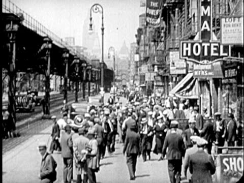 b/w montage 1930s people in bowery neighborhood / new york city, new york - lower east side bildbanksvideor och videomaterial från bakom kulisserna