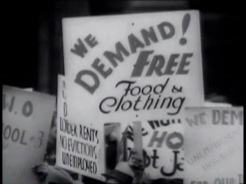 1930s cu picket signs at unemployment demonstration / new york new york united states - placard stock videos & royalty-free footage