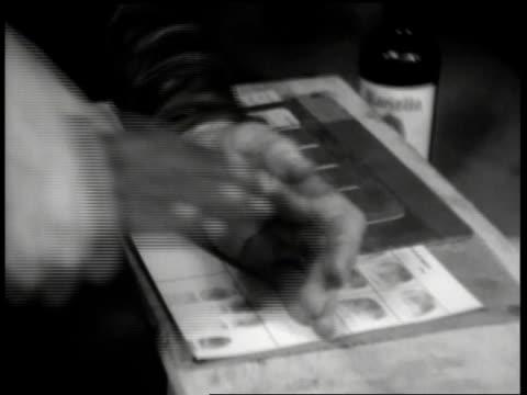 1930s cu police fingerprinting man / united states - arrest stock videos & royalty-free footage