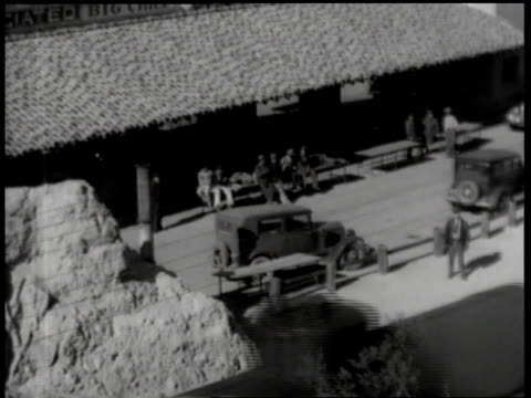 1930s ms policeman riding atop train passing through station / united states - c119gs点の映像素材/bロール