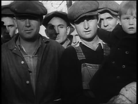 1930s portrait group of migrant workers with small boy in hats outdoors during great depression - emigration and immigration stock videos & royalty-free footage