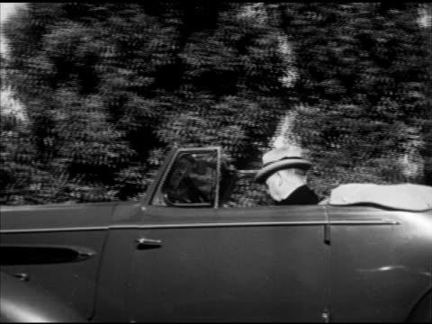 charles evans hughes w/ man at door, herbert hoover driving convertible, opening suicide door, walking into home. mot 1940s: henry stimson w/ general... - 自殺点の映像素材/bロール