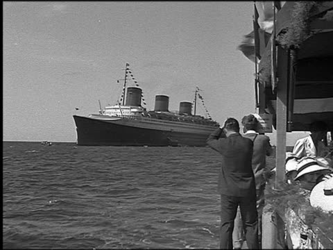 b/w 1930s rear view two men on launch taking photographs of cruise ship on ocean / martinique - 1935 stock-videos und b-roll-filmmaterial