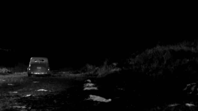 a 1930s roadster travels down a grassy hill at night. - 1930 1939 stock videos & royalty-free footage
