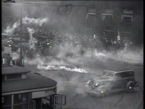 1930s ws smoking canisters breaking up demonstration / new york new york united states - einige gegenstände mittelgroße ansammlung stock-videos und b-roll-filmmaterial