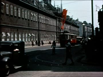 1930s street w/traffic, red swastika flags / vienna, austria - 1930 1939 stock videos & royalty-free footage