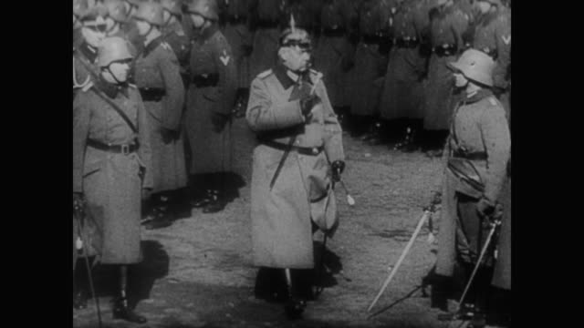 1930s, the german army marches across the screen and the treaty of versailles and the creation of the officers of the ss are discussed as they... - german military stock videos & royalty-free footage