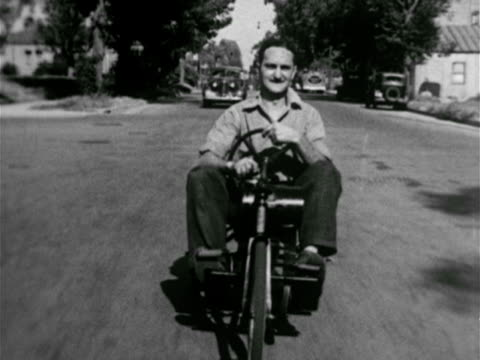the great depression vs car modified to use steam power la ms man riding motorized bicycle teenagers riding oversized soap box car w/ rear engine man... - bicycle seat stock videos & royalty-free footage
