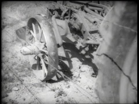 stockvideo's en b-roll-footage met 1930s cu tractor pulling plow / united states - grote depressie nieuwsevenement