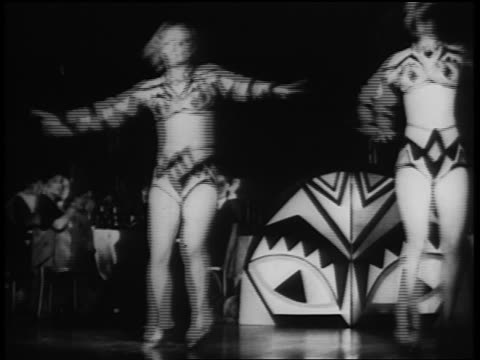 b/w 1930s two women in hot pants + midriff-baring shirts dancing on stage in nightclub - showgirl stock videos and b-roll footage