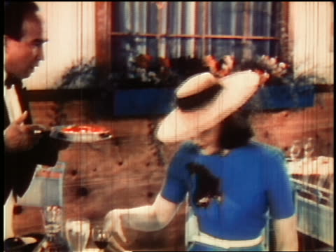 1930s ms waiter spills soup on woman sitting at table / woman pours water on dress + stain vanishes - embarrassment stock videos & royalty-free footage