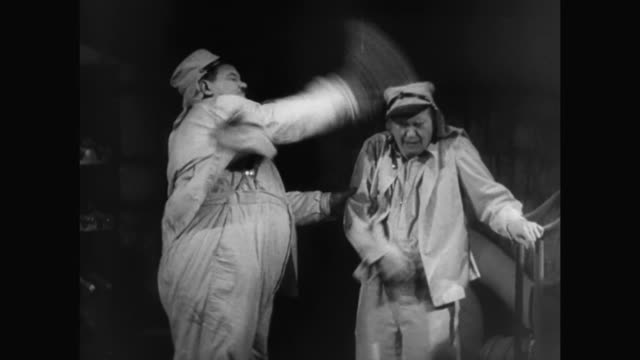 1930s while making a prison escape, laurel and hardy have trouble remaining quiet - 1930 1939 stock-videos und b-roll-filmmaterial
