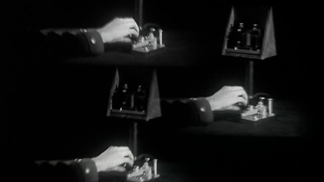1930s wide shot spinning montage of hand tapping message on telegraph - telegraph stock videos & royalty-free footage