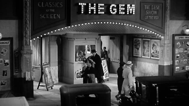 1930s wide shot the gem movie theatre marquee set with ticket booth, parked cars and pedestrians in front - ticket counter stock videos & royalty-free footage