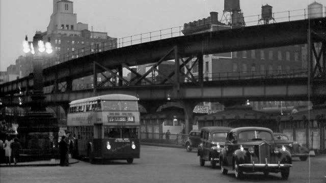 b/w 1930s wide shot pan traffic exiting the queensboro bridge with overpass / new york city - 1930 stock videos and b-roll footage