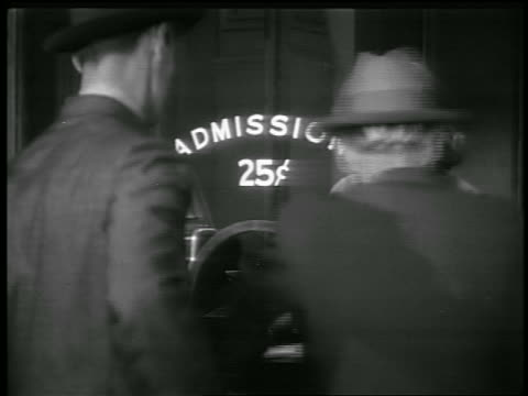 b/w 1930s woman selling tickets in booth at theater - ticket stock videos & royalty-free footage