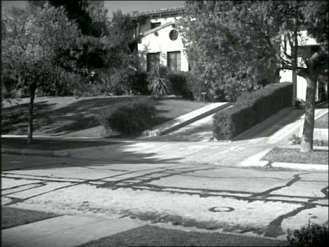 b/w 1930s woman + two boys exit house + get into parked car with man in driveway - 1930 stock videos and b-roll footage