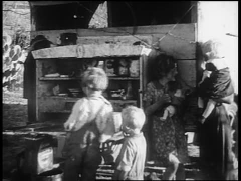 b/w 1930s woman with baby children standing behind truck / homless dust bowl families - dust bowl stock videos and b-roll footage
