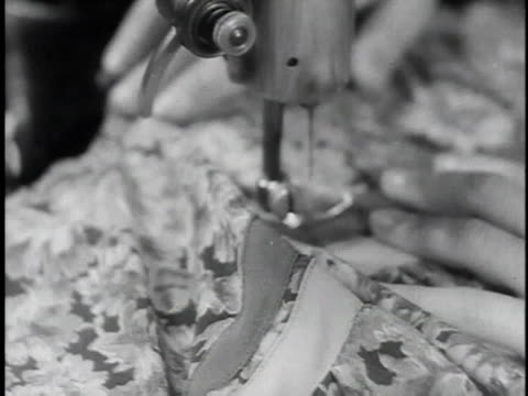 1930s cu woman's hands moving fabric under sewing machine needle / dombrova poland - macchina per cucire video stock e b–roll