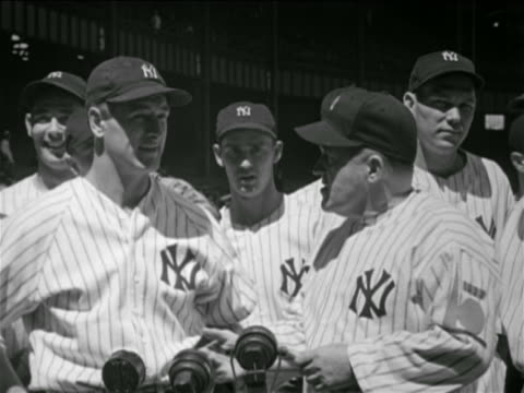 b/w 1930s yankees manager joe mccarthy shaking hands with lou gehrig / other players in background - lou gehrig stock videos & royalty-free footage