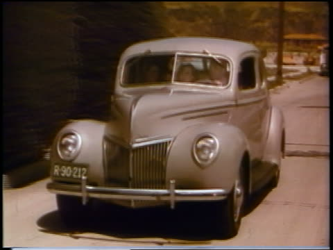 1930s young man + 2 women driving in ford car / commercial - ford motor company stock videos and b-roll footage