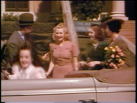 1930s young woman + 2 friends getting into new Ford convertible as parents look on / commercial