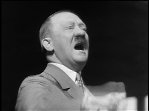 b/w 1930s/40s close up adolf hitler shouting speech pounding fist outdoors - adolf hitler stock-videos und b-roll-filmmaterial