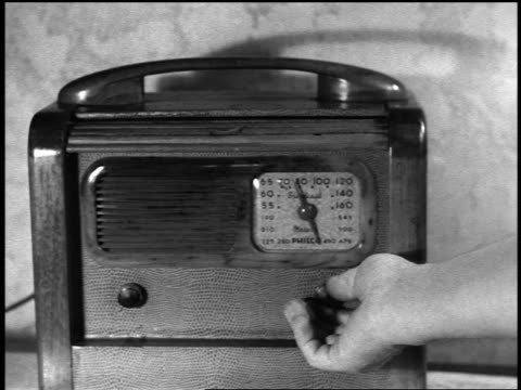 b/w 1930s/40s close up man's hand turning knob on philco radio - radio stock videos & royalty-free footage