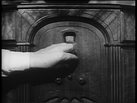 b/w 1930s/40s close up man's hand turning knob on radio - yorkville illinois stock videos & royalty-free footage