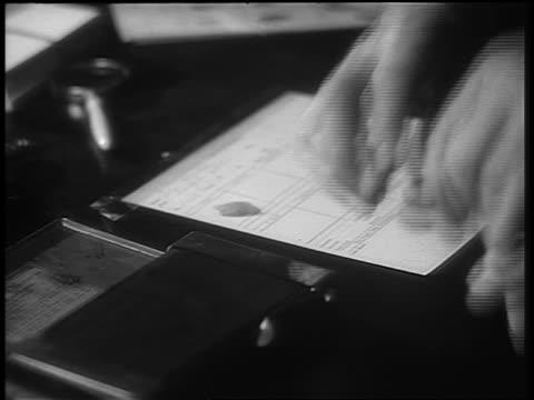 b/w 1930s/40s close up man's hands fingerprinting second man - fingerprint stock videos & royalty-free footage