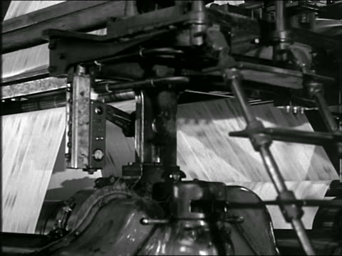 b/w 1930s/40s close up newspaper presses running in plant - 1930 stock videos and b-roll footage