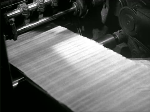 b/w 1930s/40s close up newspapers running on conveyor belt in printing plant - 1930 stock videos and b-roll footage
